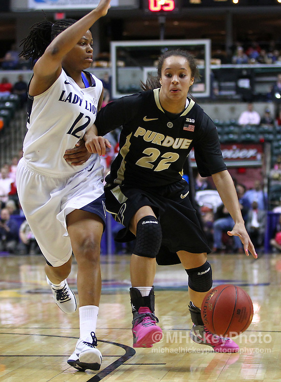 March 03, 2012; Indianapolis, IN, USA; Purdue Boilermakers guard KK Houser (22) dribbles the ball against Penn State Lady Lions guard Zhaque Gray (12) during the semifinals of the 2012 Big Ten Tournament at Bankers Life Fieldhouse. Purdue defeated Penn State 68-66. Mandatory credit: Michael Hickey-US PRESSWIRE