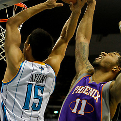 February 2, 2012; New Orleans, LA, USA; New Orleans Hornets power forward Gustavo Ayon (15) has his shot blocked by Phoenix Suns forward Markieff Morris (11) during the second quarter of a game at the New Orleans Arena.   Mandatory Credit: Derick E. Hingle-US PRESSWIRE