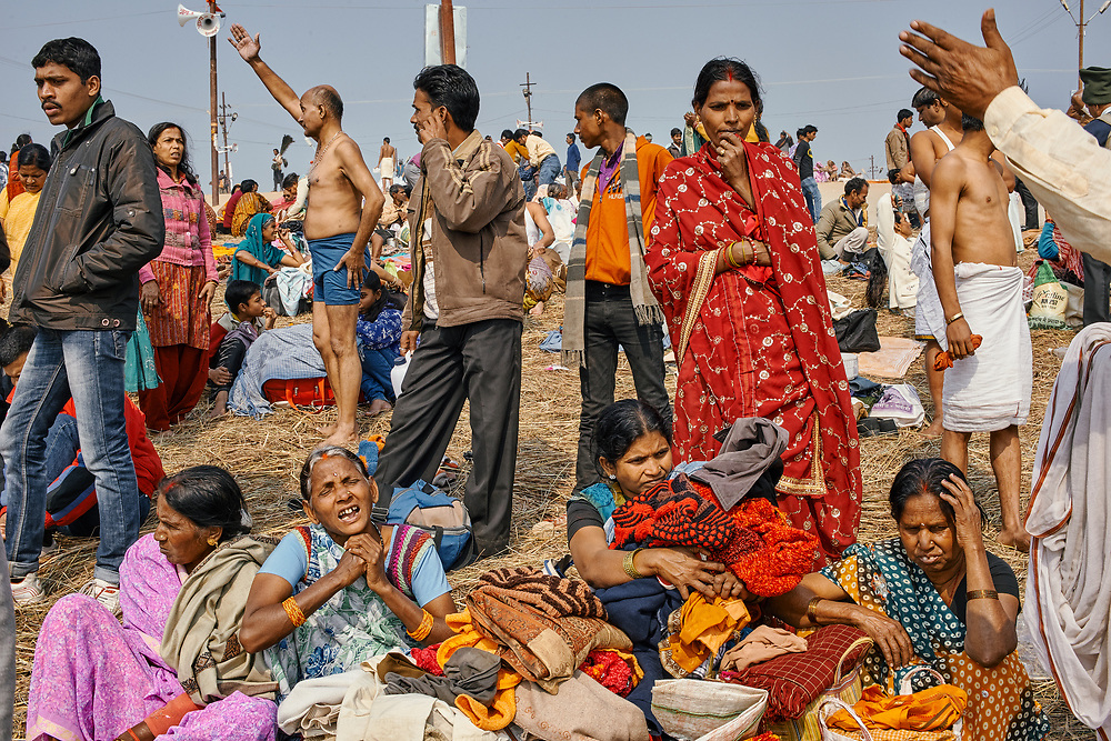 Gathering of people near the Triveni Sangam, where three rivers (Ganga, Yamuna and Saraswati) merge into one, on one of the main bathing dates (Paush Purnima) during the Kumbh Mela in Allahabad, Uttar Pradesh.