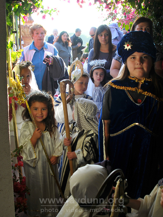"In a pre-Christmas tradition which began in 1957, the Jimenez family of Castroville put on their annual ""posada,"" with friends, family and guests celebrating the holiday season together on Dec. 15th. Posada"" means ""inn"" in Spanish, and for this occasion, children dressed as Biblical figures reenacted Mary and Joseph's search for shelter during their Biblical journey from Nazareth to Bethlehem. Moving from house to house, the ""peregrinos,"" or pilgrims, trade touching verses in song with the ""hosteleros,"" the innkeepers, inside, until at last, shelter is found."