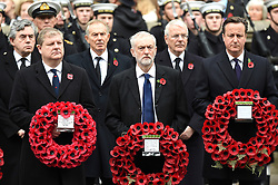 © Licensed to London News Pictures. 08/11/2015. London, UK. JEREMY CORBYN and DAVID CAMEON holding wreaths as they attend the Remembrance Sunday Service at the Cenotaph in Westminster, Central London.. Photo credit: Ben Cawthra/LNP