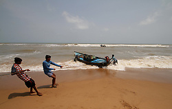 April 30, 2019 - Bhubaneswar, Odisha, India - Sea fishing boats are seen at the Konark beach of Puri district and fishermen prepares to ashore their boats to the beach as they withdraw from the Sea fishing after cyclone 'Fani' alert to landfall on Bay of Bengal Sea's eastern coast beach in Odisha state near by 100 km east from the eastern Indian state Odisha's capital city Bhubaneswar on 1st May 2019. (Credit Image: © Str/NurPhoto via ZUMA Press)