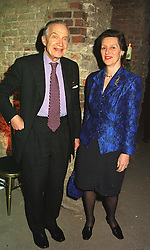 SIR MARTIN & LADY JACOMB at a reception in London on 16th March 1999.MPI 6