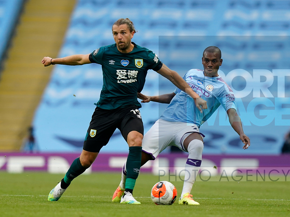 Jay Rodriguez of Burnley tackled by Fernandinho of Manchester Cityduring the Premier League match at the Etihad Stadium, Manchester. Picture date: 22nd February 2020. Picture credit should read: Andrew Yates/Sportimage