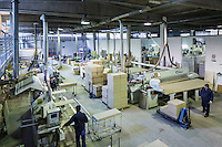 SOVERIA MANNELLI, ITALY - 16 NOVEMBER 2016: Beechwood is cut here by workers in the warehouse of Camillo Sirianni, a school furniture manifacturer in Soveria Mannelli, Italy, on November 16th 2016.<br /> <br /> Camillo Sirianni is a third generation family business that started as a family mechanized carpentry in 1909 and transformed into a leading school furniture manufacturer. In a high-tech warehouse in the outskirts of Soveria Mannelli, they assemble thousands of Calabrian beechwooden, colorful desks, benches, closets and other accessories that are later shipped to many corners of the globe, from the United Kingdom to the Emirates, from central America to Polynesia.<br /> <br /> Soveria Mannelli is a mountain-top village in the southern region of Calabria that counts 3,070 inhabitants. The town was a strategic outpost until the 1970s, when the main artery road from Naples area to Italy's south-western tip, Reggio Calabria went through the town. But once the government started building a motorway miles away, it was cut out from the fastest communications and from the most ambitious plans to develop Italy's South. Instead of despairing, residents benefited of the geographical disadvantage to keep away the mafia infiltrations, and started creating solid businesses thanks to its administrative stability, its forward-thinking mayors and a vibrant entrepreneurship numbering a national, medium-sized publishing house, a leading school furniture manufacturer and an ancient woolen mill.