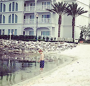 Images of young boy taken in same spot at the Floridian hotel in orlando <br /> where little 2 year old boy was snatched by an alligator below is mum  Jennifer Venditti account...<br /> <br /> so hard for the family & for those who witnessed this tragic event. I took these pics at the exact spot this happened between 8 & 8.30, the incident happened at 9. Helicopters flew overhead until 1 am and were back around dawn. I can't imagine anyone could sleep knowing that the helicopter was searching for a missing child taken by an alligator. I can't help but wonder if we played with him, did I talk to his Mom?? How does one go home without your baby in tow? 💔 I've already seen posts criticizing the parents. I can assure you alligators were not on my mind at all when Channing was in the water. It's a tiny beach, surrounded by pools, water slides, a restaurant and a fire pit. I can't conceive that an alligator would be in such a busy, small space. <br /> © Jennifer Venditti/Exclusivepix Media