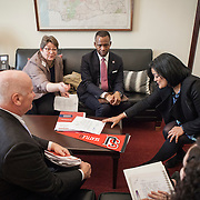 Representative Pramila Jayapal (D-WA, 7), and her legislative assistant, Danielle Fulfs, right, listen to (from left), Larry Probus, Violet Boyer and Isiaah Crawford of the National Association of Independent Colleges and Universities, on Tuesday, January 31, 2017.  This was the last of four 30-minute meetings with constituent advocacy groups during the day.  John Boal photo/for The Stranger