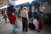 A traveller hires Alamin Hasan (right) to carry his luggage at the Kamalapur Railway Station in Dhaka, Bangladesh, where he works as a porter. (Featured in the book What I Eat: Around the World in 80 Diets.) MODEL RELEASED.