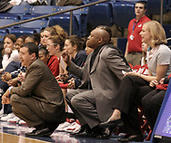 The Flyers head coach Jim Jabir (left) watches from the sidelines in the first half of a UD Women's basketball game at the University of Dayton Arena, January 21, 2007.