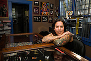 Angela is a staple of Cooper Young and Midtown Memphis with her awesome tattoo & body piercing studio, Underground Art.  She has been in business for more than 18 years now, and is weathering even these tough economic times. Her shop has been voted Best Tattoo shop in the Memphis Flyer for the last 12 years straight, so if you want a tattoo or piercing, this is the place to go.  She also supports various local groups (such as Friends for Life, WKNO and Memphis Roller Derby) by providing tattoo certificates for auctions/fundraisers.   Her shop is a cool place with great art both inside and out, so even if you don't want a tattoo, you should stop by and check it out. When she's not running her business, she is always immersed in the arts in some way, whether it's writing or photographing, and she has even produced one local play.