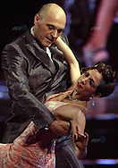 The Italian couple of Cinzia Lombardi (R) and Luciano Donda dance during the semifinal round of the Stage Tango competition at the Tango Dance World Championship in Buenos Aires on August 25, 2012.   AFP PHOTO / Alejandro PAGNI