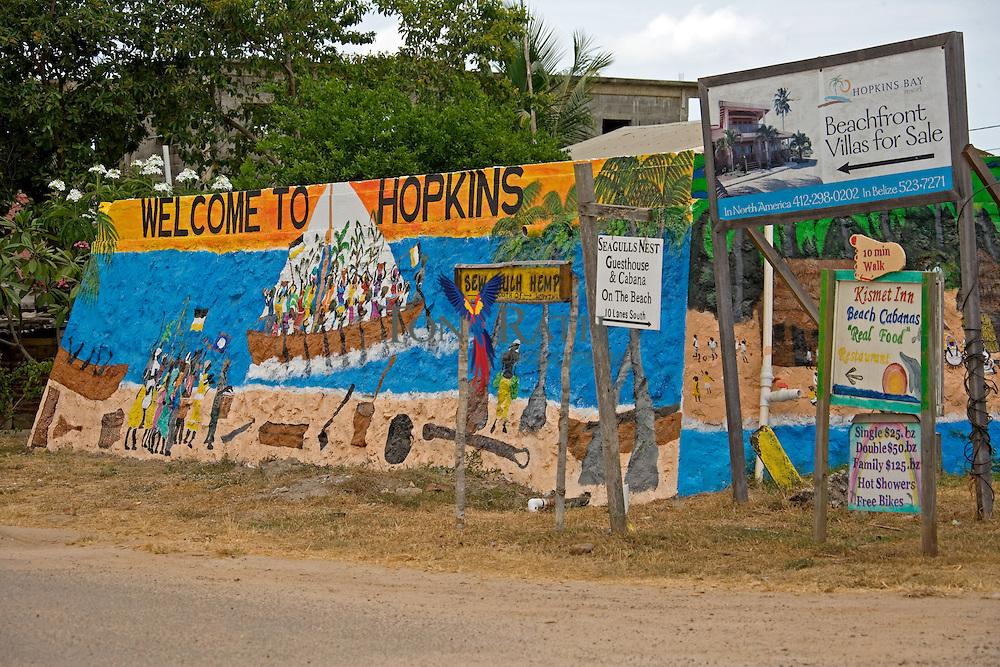 Signs at entrance to Hopkins Village, Belize