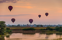 BAGAN, MYANMAR - CIRCA DECEMBER 2013: Hot air balloons flying over the plains of Bagan early morning.