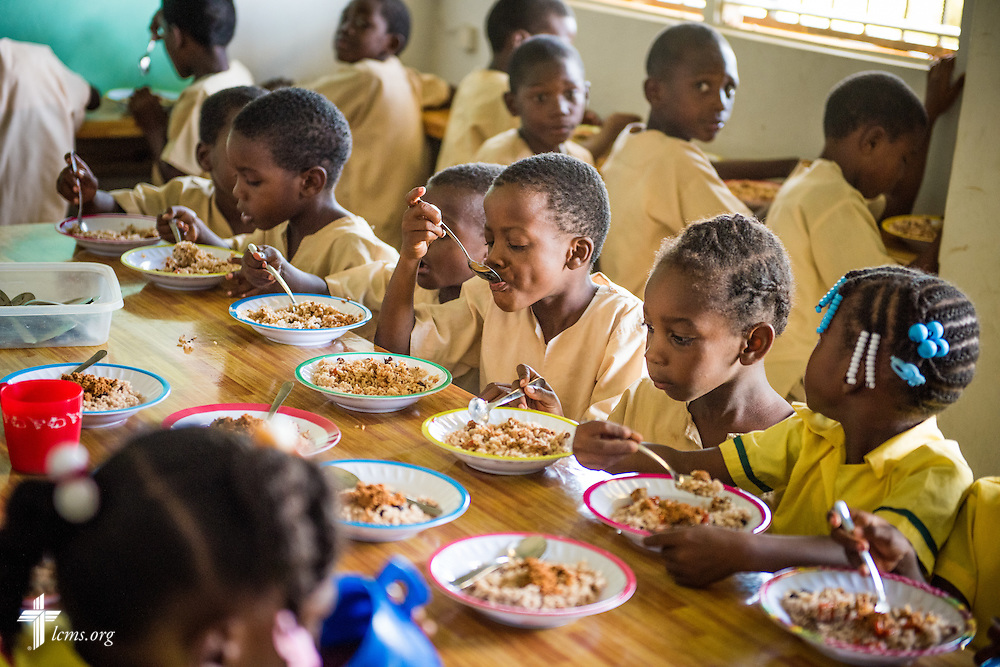 Young students eat lunch provided by the Belize Mission Society at St. Alphonsus school on Tuesday, Sept. 27, 2016, in Seine Bight, Belize. LCMS Communications/Erik M. Lunsford