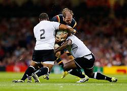 Wales Lock Alun Wyn Jones is tackled by Fiji Hooker Sunia Koto - Mandatory byline: Rogan Thomson/JMP - 07966 386802 - 01/10/2015 - RUGBY UNION - Millennium Stadium - Cardiff, Wales - Wales v Fiji - Rugby World Cup 2015 Pool A.