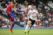 Crystal Palace defender, Damien Delaney (27) beating Fulham striker, Matt Smith (09) to the bal during the Pre-Season Friendly match between Fulham and Crystal Palace at Craven Cottage, London, England on 30 July 2016. Photo by Matthew Redman.