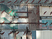 Exposed wall at a construction site on 8th Avenue and 55th Street in Manhattan, New York City.