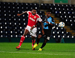 Bristol City's Jay Emmanuel-Thomas and Wycombe Wanderers' Kortney Hause give chase to the loose ball - Photo mandatory by-line: Joe Dent/JMP - Tel: Mobile: 07966 386802 08/10/2013 - SPORT - FOOTBALL - London Road Stadium - Peterborough - Peterborough United V Brentford - Johnstone Paint Trophy