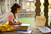 19 MARCH 2006 - SIEM REAP, SIEM REAP, CAMBODIA: A school girl drawings for sale to tourists in the entrance to the main Angkor Wat complex near Siem Reap, Cambodia. Cambodian authorities estimate that more than one million tourists will visit Angkor Wat in 2006, making it the leading tourist attraction in Cambodia by a large margin.   Photo by Jack Kurtz / ZUMA Press