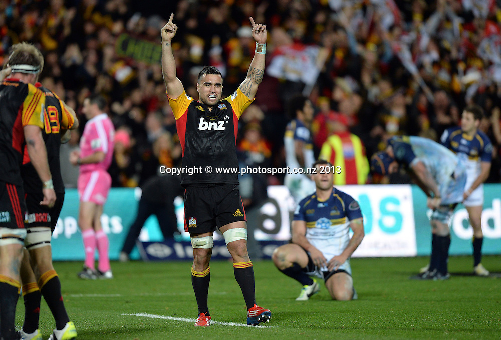 Chiefs captains Liam Messam celebrates as George Smith is dejected after the Chiefs defeated the Brumbies 27-22. Super Rugby Final. Chiefs v Brumbies. Waikato Stadium, Hamilton, New Zealand on Saturday 3 August 2013. Photo: Andrew Cornaga/www.Photosport.co.nz