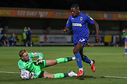 AFC Wimbledon attacker Michael Folivi (17) rounds Brighton and Hove Albion goalkeeper Jason Steele (23) during the EFL Trophy (Leasing.com) match between AFC Wimbledon and U23 Brighton and Hove Albion at the Cherry Red Records Stadium, Kingston, England on 3 September 2019.