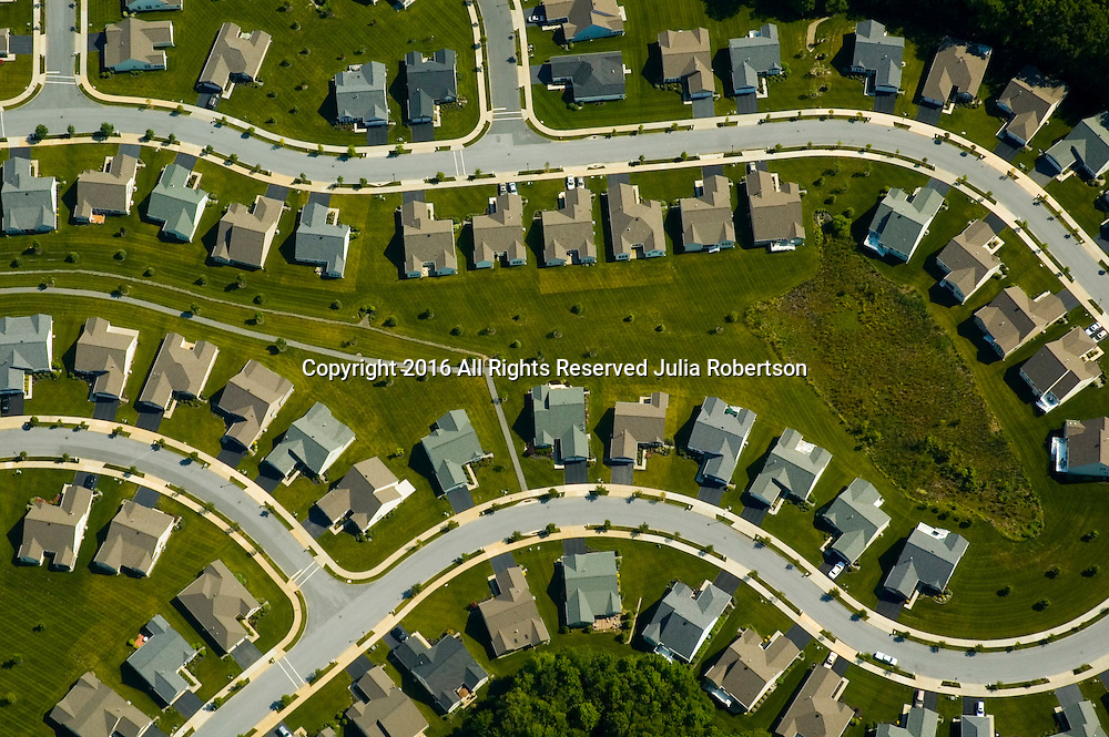 Aerial view of Housing Development<br /> (Monopoly Pieces or stitching in the earth) Aerial views of artistic patterns in the earth.