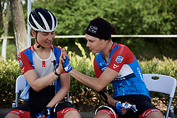 Gabrielle Pilote Fortin (CAN) and Lara Vieceli (ITA) are hand twins at Tour of Chongming Island 2019 - Stage 2, a 126.6 km road race from Changxing Island to Chongming Island, China on May 10, 2019. Photo by Sean Robinson/velofocus.com