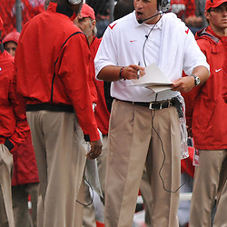 Sep 12, 2009; Piscataway, NJ, USA;  Rutgers head coach Greg Schiano talks with staff during the first half of Rutgers' 45-7 victory over Howard in NCAA College Football at Rutgers Stadium.