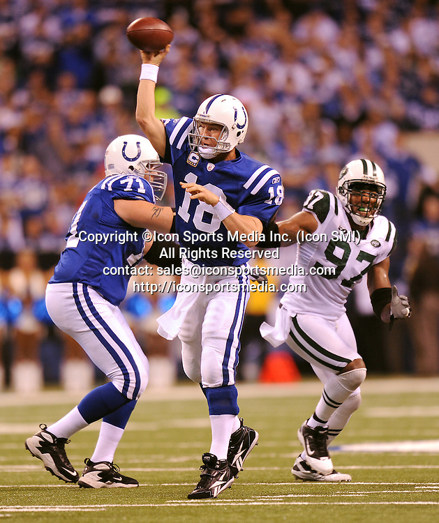 January 24, 2010: New York Jets at Indianapolis Colts AFC Championship game at Lucas Oil Stadium in Indianapolis, IN: Colts quaterback Peyton Manning throws under pressure as Jets #97 Calvin Pace looks for a sack.