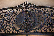 Detail on an iron bench in the Tea House at the Biltmore Estate privately owned by the Vanderbilt family in Asheville, NC. The house is the largest private home in America with over 250 rooms.