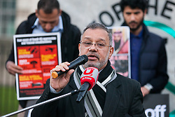 London, UK. 26th March, 2019. A Bahraini speaker addresses human rights campaigners from several different groups including Stop The War Coalition and Campaign Against the Arms Trade protesting opposite Downing Street against British arms sales to Saudi Arabia used to wage a 4-year war in Yemen. According to charity Save The Children, an estimated 85,000 children under the age of five may have died from acute malnutrition since the war began in 2015 and 14 million Yemenis are believed to face the risk of famine; according to the United Nations, millions of citizens have been displaced, over 56,000 Yemenis have been killed and the country is facing the 'world's worst humanitarian crisis'.