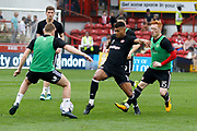 Brentford players warm up before kick off during the EFL Sky Bet Championship match between Brentford and Queens Park Rangers at Griffin Park, London, England on 21 April 2018. Picture by Andy Walter.