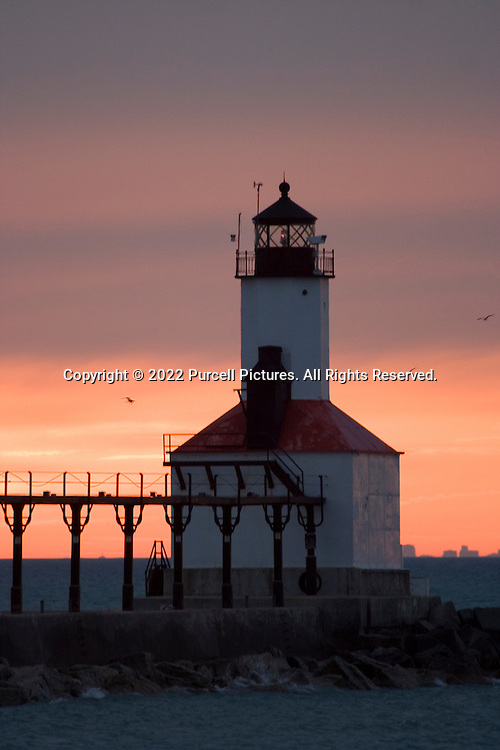 Lighthouse at Washington Park in Michigan City, Indiana after sunset against a colorful sky