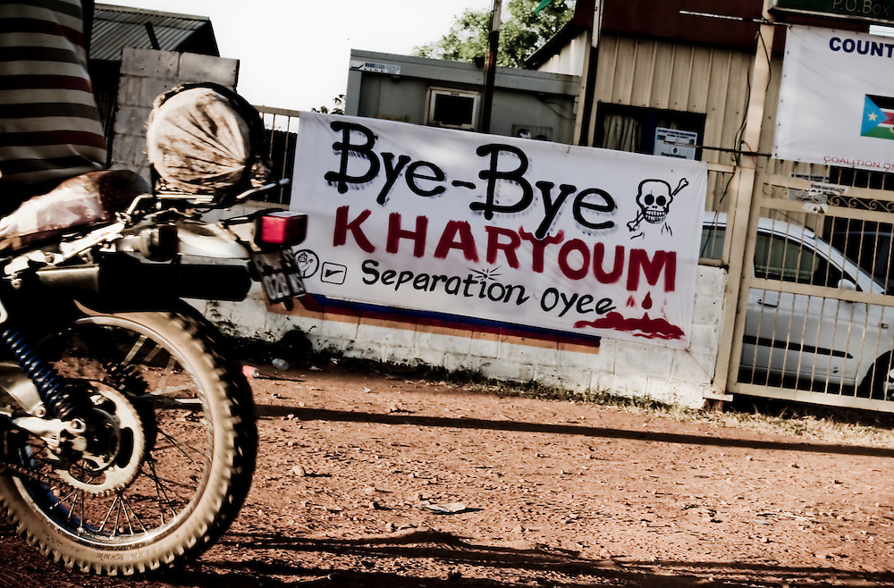 "A poster reading ""Bye Bye Khartoum"" decorates Southern Sudan's capital city Juba. Southern Sudan will vote on January 9 to decide whether or not to remain as part of Sudan or set off alone as the world's newest country. (© William B. Plowman)"