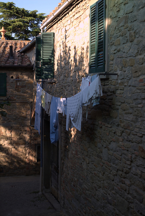 Laundry drying on clothsline in Cortona, Italy