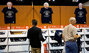 Berkshire Hathaway shareholders looks over t-shirts for sale featuring images of CEO Warren Buffett and vice chairman Charlie Munger at the shareholder shopping day as part of the Berkshire Hathaway annual meeting weekend in Omaha, Nebraska May 5 2017. REUTERS/Rick Wilking