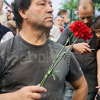 Man holding carnations.