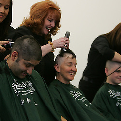 There were so many Tulane Students and faculty to volunteer to shave that three and four people took to the chair at once.