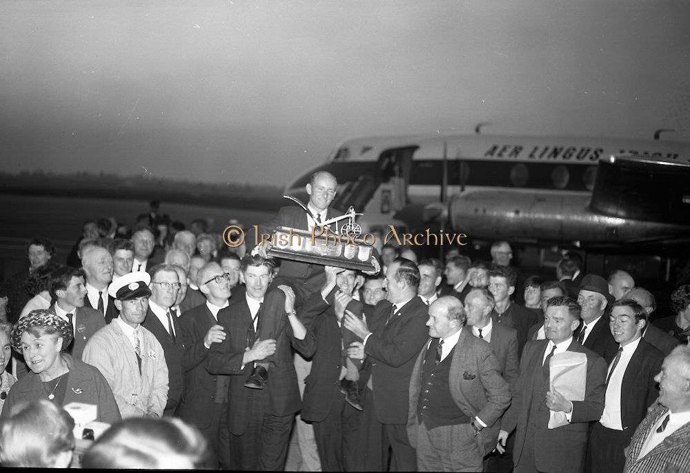 Mr. Charlie Keegan, the new World Champion Ploughman proudly shows the Esso Golden Plough, which he won in Austria, to his family..04.10.1964