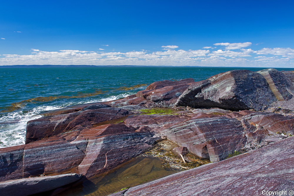 Rocky shoreline on the  island of Isle-Verte in the St. Lawrence River<br />