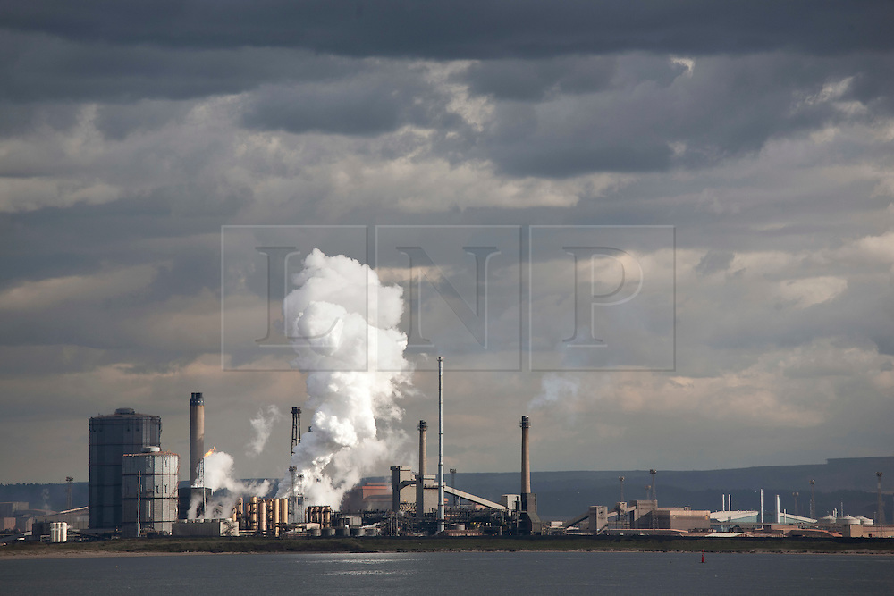 © Licensed to London News Pictures. 29/10/13.Teesside. Tata Steel says it plans to cut up to 500 jobs in Scunthorpe, Workington and Teesside because of weak demand in the construction industry FILE PICTURE of the Steel works on Teesside. Molten metal is seen in the blast furnace. Photo credit should read Reuben Tabner/LNP