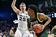 Manny Camper (3) of Siena dribbles the ball past Jason Carter (25) of Xavier during an NCAA college basketball game, Friday, Nov. 8, 2019, at the Cintas Center in Cincinnati, OH. Xavier defeated Siena 81-63. (Jason Whitman/Image of Sport)