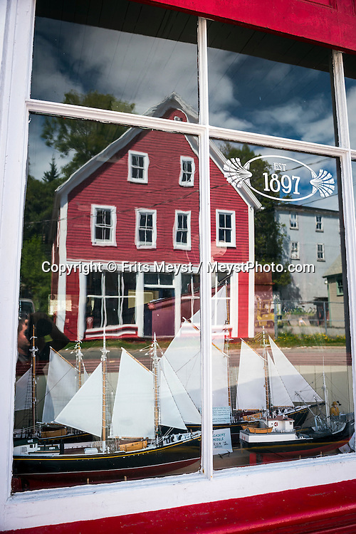 "Lunenburg, Nova Scotia, Canada, August 2014. Old Town Lunenburg is one of only two urban communities in North America designated as a UNESCO World Heritage site. Considered to be the best surviving planned British colonial town in North America, you can still see the tall ships moored off the port. Nova Scotia was one of the original four provinces that became part of Canada in 1867.  ""Nova Scotia"" is Latin for ""New Scotland"", and Scottish settlers brought culture and traditions that continue to this day. Photo by Frits Meyst / MeystPhoto.com"