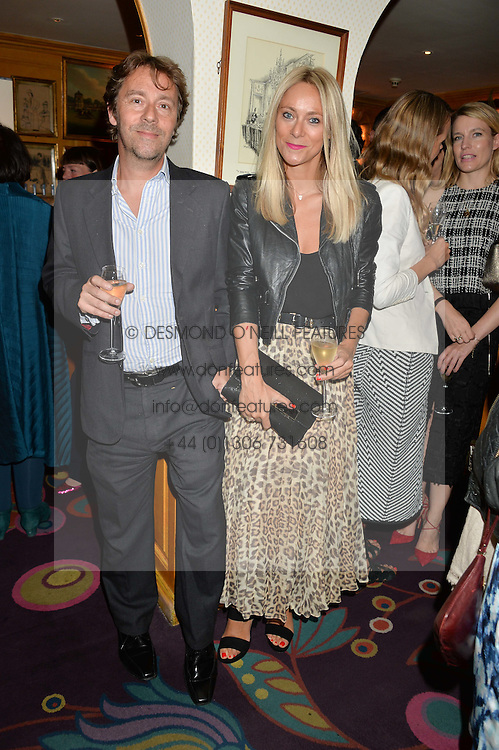 LEE & ALICE STONE at an exclusive dinner for Iris Apfel held at Annabel's, Berkeley Square, London on 29th July 2015.