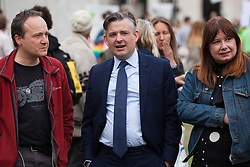London, UK. 23rd April 2019. Jon Ashworth MP, Shadow Health Minister, prepares to address climate change activists from Extinction Rebellion at an assembly in Parliament Square prior to an attempt to deliver to Parliament activists' letters requesting meetings to discuss climate change with their Members of Parliament.