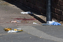 © Licensed to London News Pictures. 11/06/2018. London, UK. Blood stains, medical dressings and gloves are seen on the pavement after a 17 year old was critically injured in a stabbing in Harrow last night.Police are also dealing with a stabbing  incident in nearby Northolt where a 20 year old was injured.Photo credit: Peter Macdiarmid/LNP