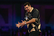 A frustrated Jose De Sousa during the PDC World Championship darts at Alexandra Palace, London, United Kingdom on 14 December 2018.during the PDC World Championship darts at Alexandra Palace, London, United Kingdom on 14 December 2018.