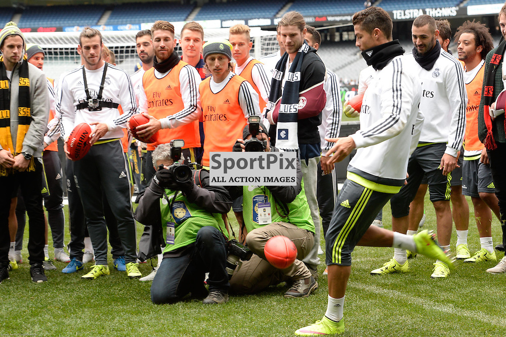 Cristiano Ronaldo shown kicking an AFL ball at Real Madrid open training session at the Melbourne Cricket Ground, 17th July 2015 at an open training session for over 10,000 fans in the lead up to the International Champions Cup game against A.S. Roma.  Melbourne Australia. © Mark Avellino | SportPix.org.uk