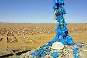 GOBI DESERT, MONGOLIA..09/03/2001.Bayanhongor (Bayankhongor). Ovoo (stone heap to honour local patron gods) on stupa hill..(Photo by Heimo Aga).