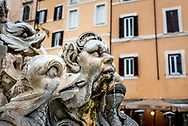 Mythical figures of Triton and sea creatures at Fontana del  Moro / Moor Fountain at Piazza Navona, Rome.